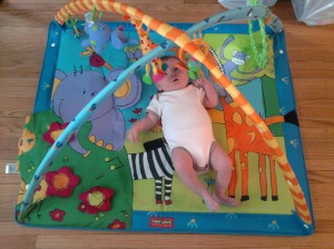 1 month-old Lynn on her playmat